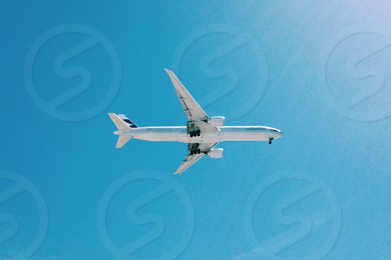 white airplane flying in sky photo