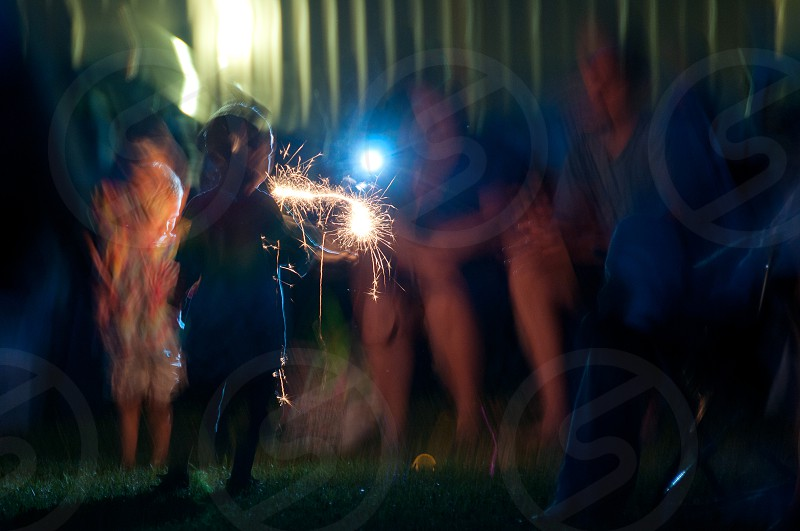 Kid with sparkler photo
