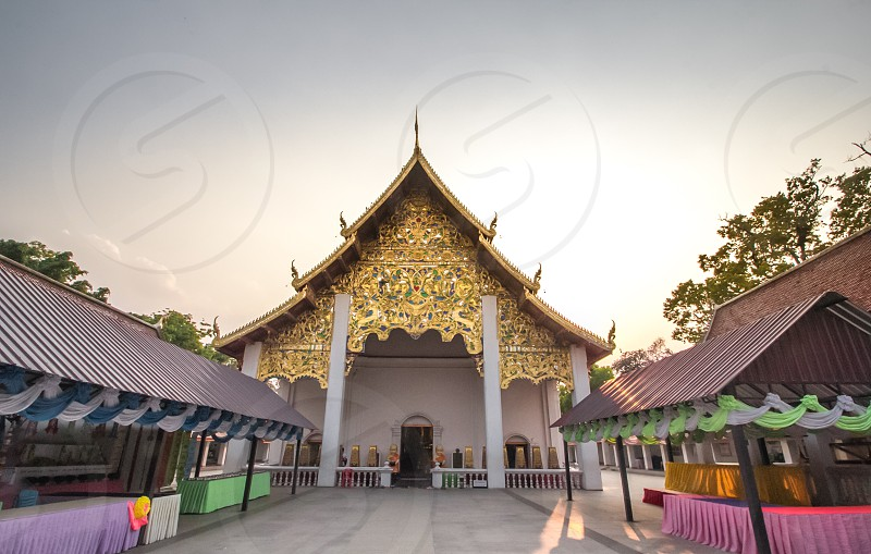 Big statue of priest and Temple at Thailand and copy space. photo