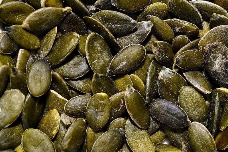 Food ingredients close up - the pumpkin seeds. photo