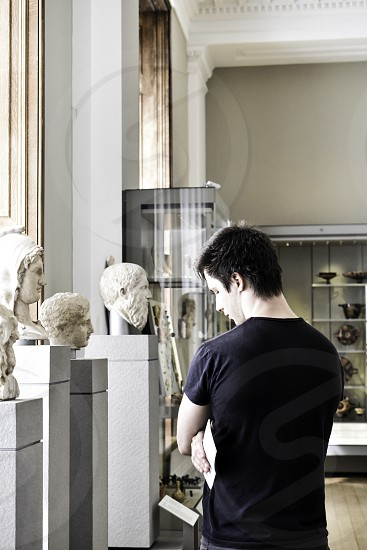 Man in museum viewing artifacts. photo
