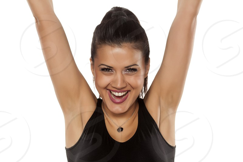 Very happy dark skinned beautiful young woman on white background photo