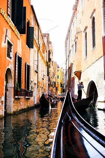 view of venice waterways with black gondolas photo