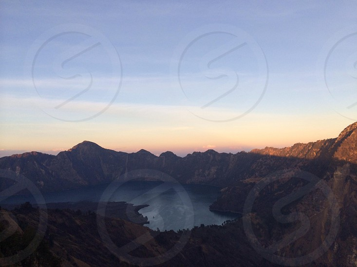 Crater lake on top of a volcano photo