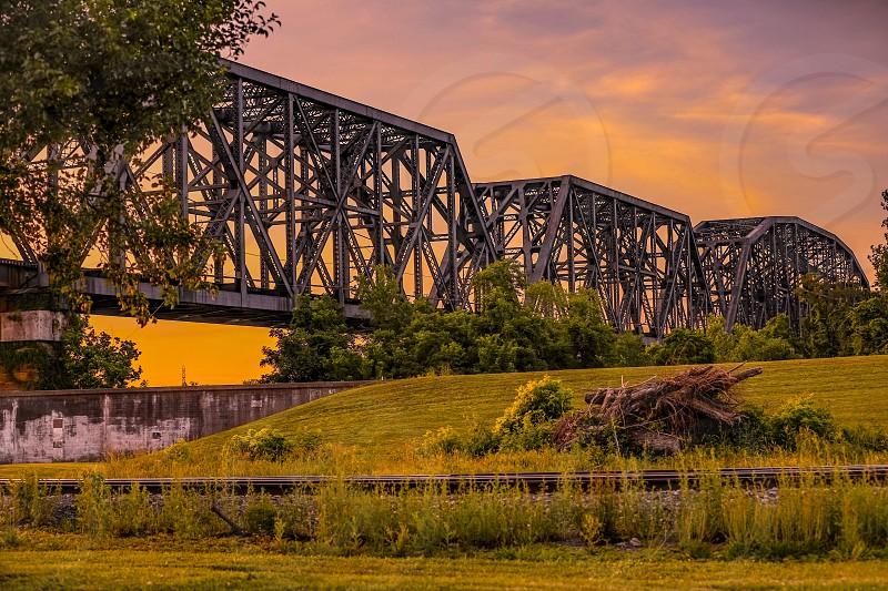 bridgesunsetsunrisetwilightlandmarklandscapesceneryscenictreetreesgrassgreeniconic photo