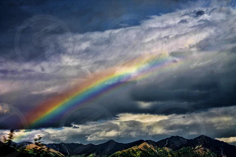 Rainbow over Alaskan mountain range near Anchorage. photo
