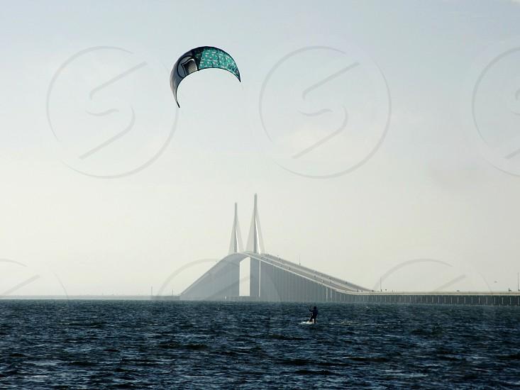 Kitesurfing on Tampa Bay Florida along the Sunshine Skyway Bridge photo