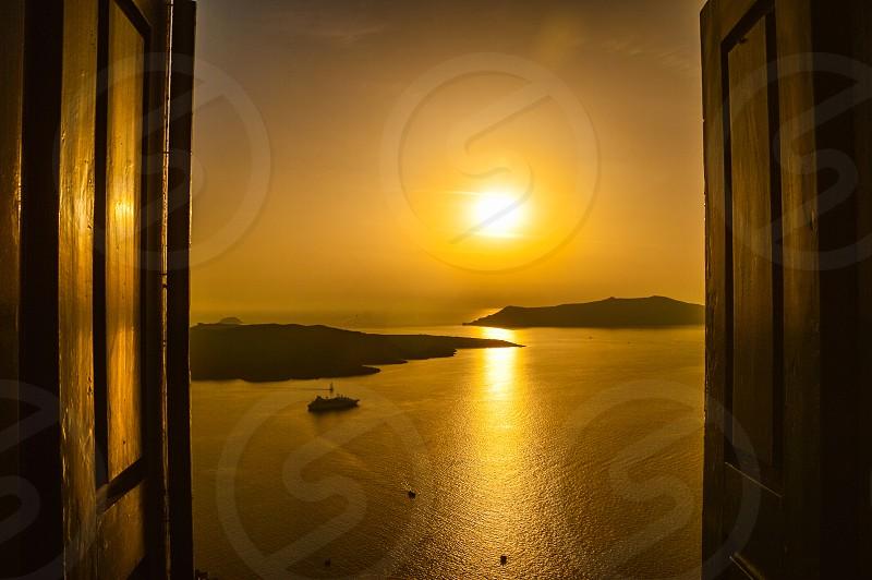 Scenic view od the Caldera of Santorini during sunset photo
