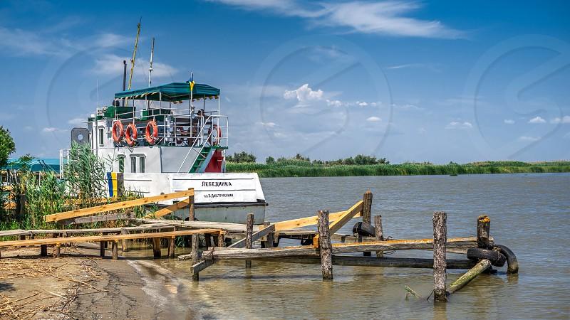 Vilkovo Ukraine - 06.23.2019. Zero kilometer - the place where the Danube flows into the Black Sea in Ukraine photo