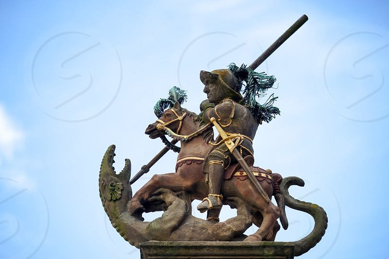 Statue on Top of St. George's Fountain in Rothenburg ob der Tauben photo