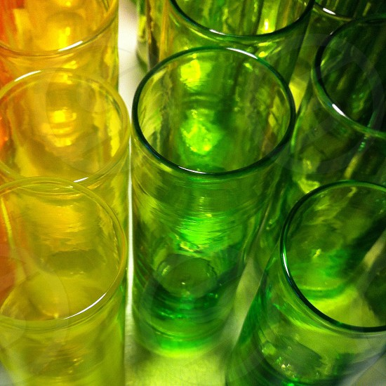 yellow and green tinted drinking glasses photo