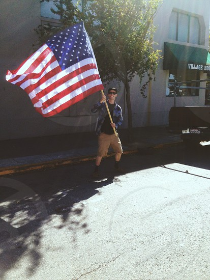 man holding the american flah photo