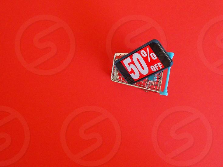 sale50% offred backgroundshoppingshopping cartiphonewordtextwordsretailretail shoppingblack fridayonline shopping photo
