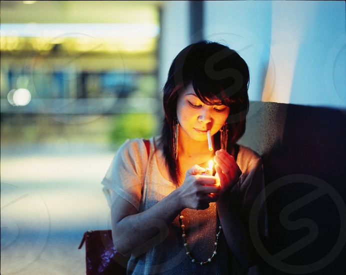 woman lighting cogarette photo