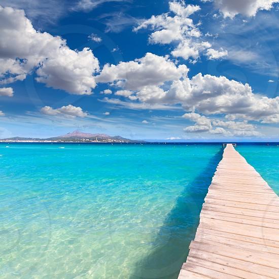 Majorca Platja de Muro beach pier in Alcudia bay in Mallorca Balearic islands of Spain photo
