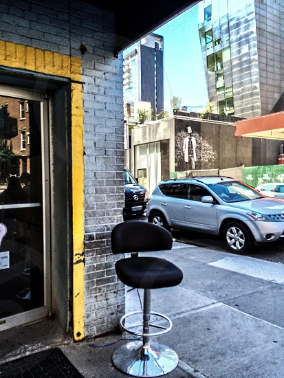 silver-based hydraulic stool on grey pavement photo