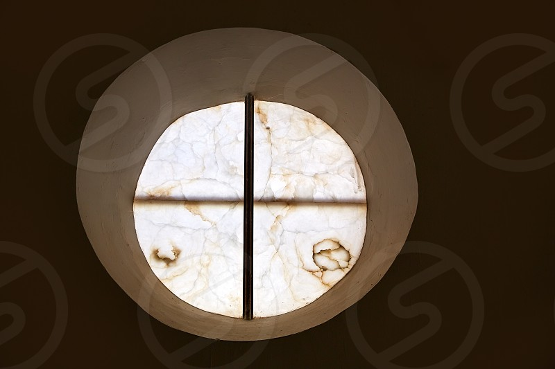 alabaster round window with cross difussed light for churches in Spain photo