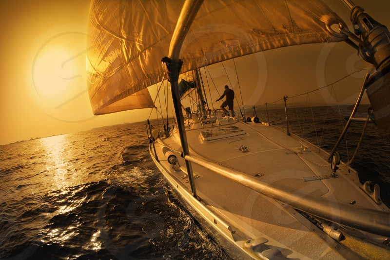 sail boat; tranquil scene; team; sunset; sunrise; sailing; ocean; boat; horizon; water; wave; summer; sea; vacation; holiday; freedom; getting away from it all; healthy lifestyle; people; active; summertime; sailboat; sail; vacationing; sailing boat; seascape; vacations; crew; oceanic; holidays; sundown; waves; summer time; independence; activity; enjoying; enjoyment; free; persons; freeing; action; leisure; relax; relaxing; traveling; travel; journey; trip photo