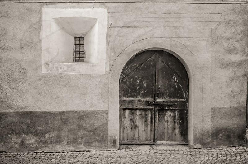 brown wooden door beside white framed window photo