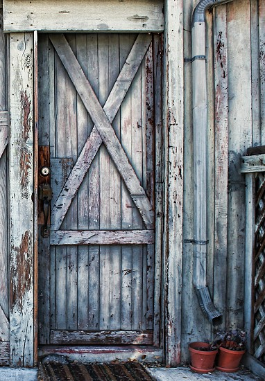 Old weathered gray and blue beach house door photo