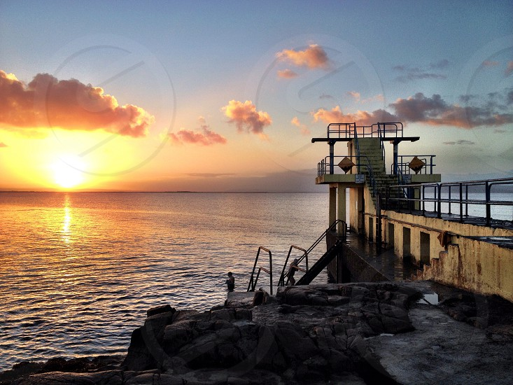 Sunrise and a morning swim at Blackrock Tower in Salthill Galway  photo