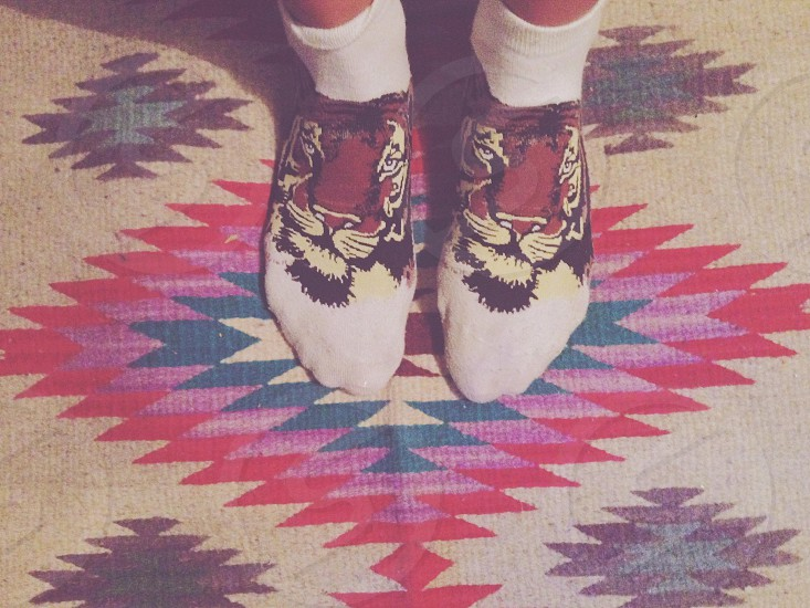 Textile rug feet socks woven carpet standing photo