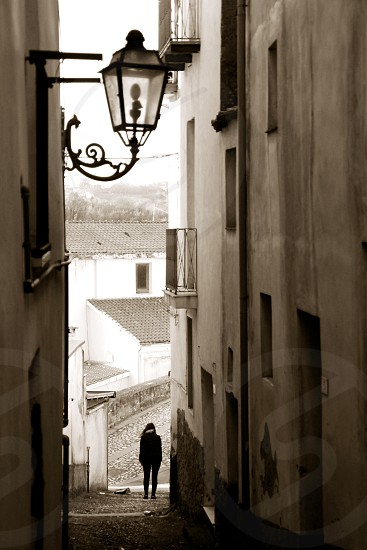 woman in alleyway in ancient village South Italy photo