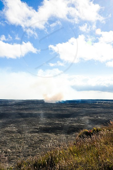 FIRE AND FLAME | Captured smoke/steam rising up from the lookout point of the Mauna Loa on the Big Island. The active volcano is a tourist spot as you can see the lava rock that has formed. photo