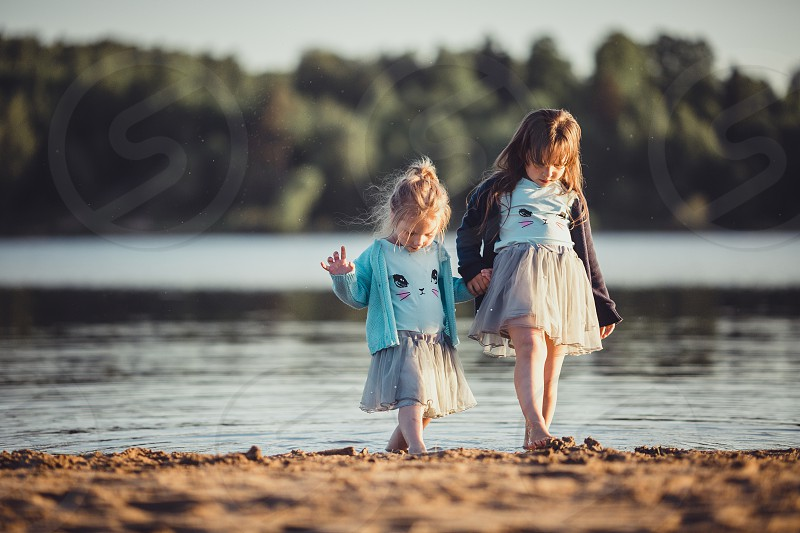portrait picnic lake summer coast child girl childhood water  outdoor . Little girl with blueberries outdoor portraits  photo
