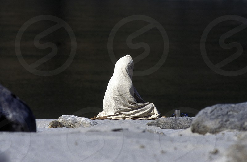 a men on the Ganges River in the town of Rishikesh in the Province Uttar Pradesh in India. photo