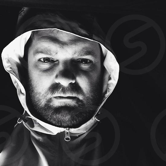 man in grey zip up hoodie photo