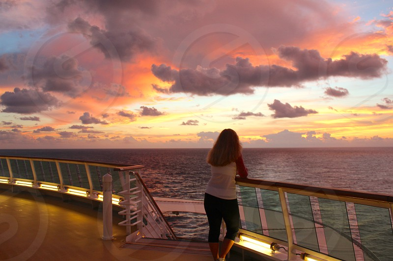 Watching sunrise from a cruise ship photo