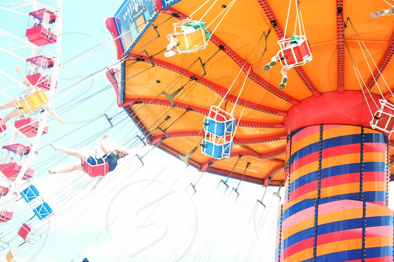 Amusement park amusement ride flying swing swinging. People  photo