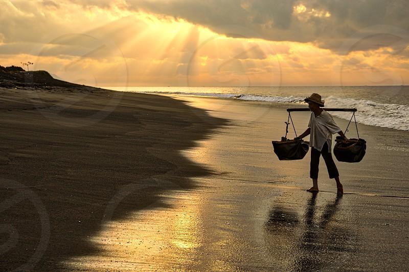 Salt Farmer Kasumba Beach Village Bali Indonesia photo