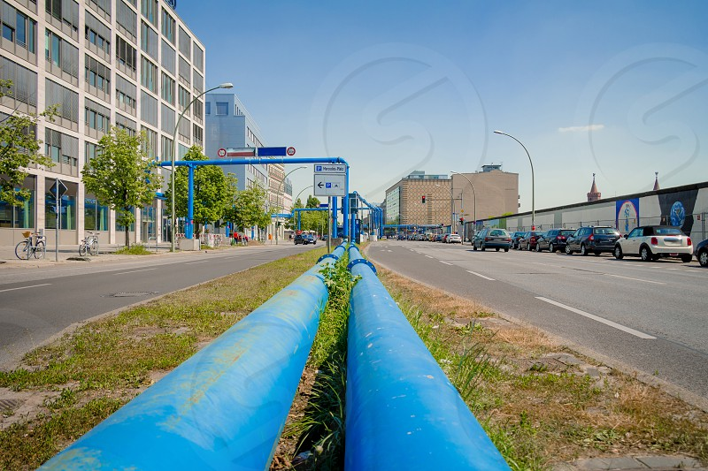 Blue pipes at the street of Berlin city. The pipes are used to pump water away from construction sites due to the city's high groundwater level. photo