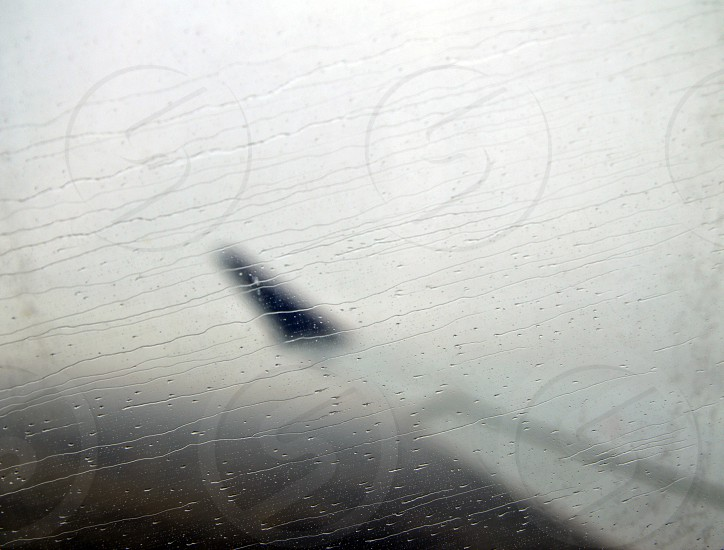 Water droplets through the window of an aircraft during takeoff. photo