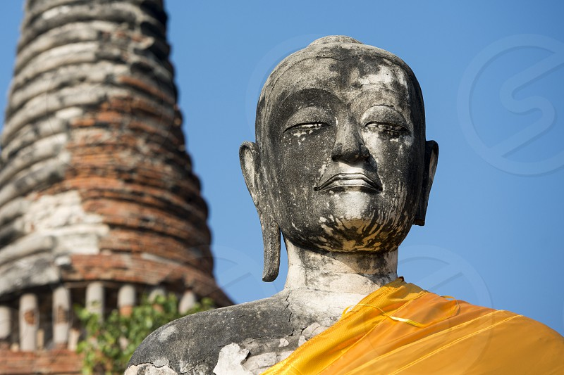 a buddha at a smal Temple of the Historical park in the city of Ayutthaya north of bangkok in Thailand in southeastasia. photo