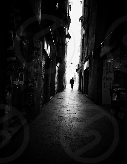 man standing on alley  photo