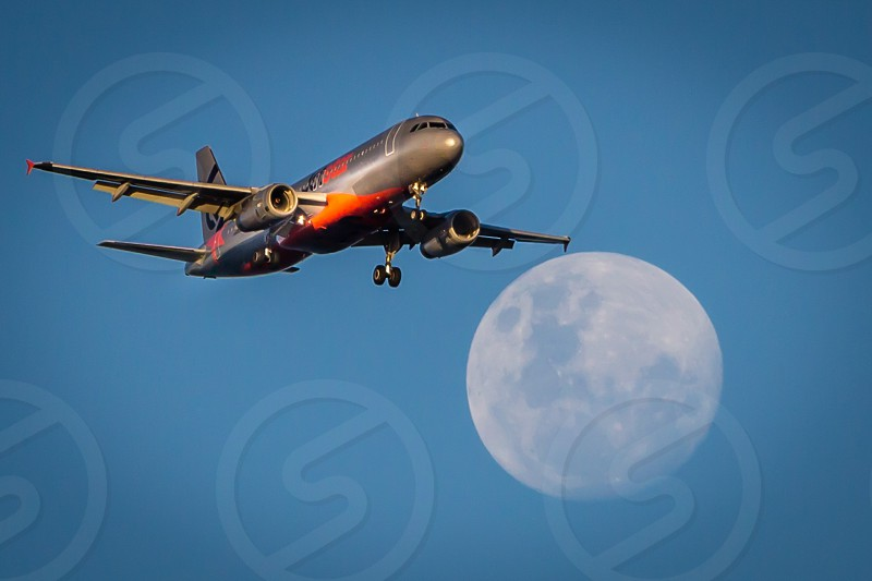 Passing the moon airplanes aeroplane passenger jets landing photo