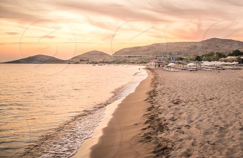 Sea Wave On The Sand Beach photo