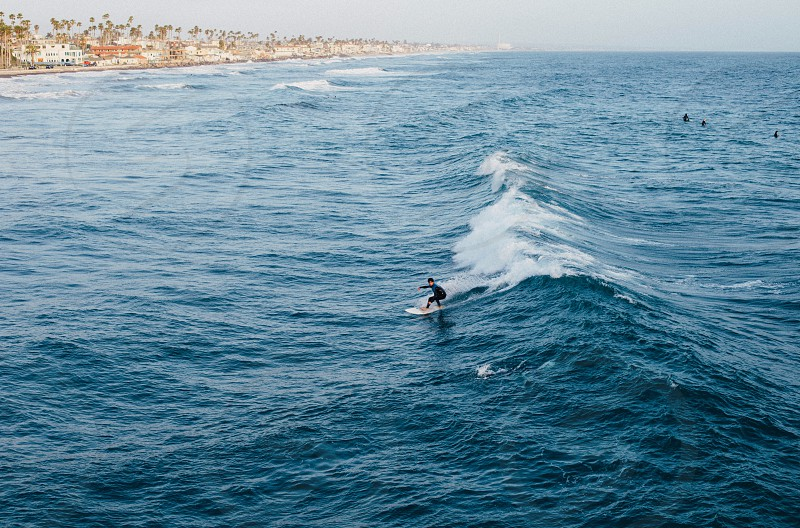person surfing on sea photo
