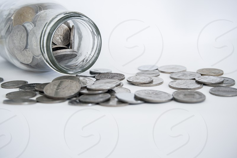 coins in the jar bottle .Finance concept photo