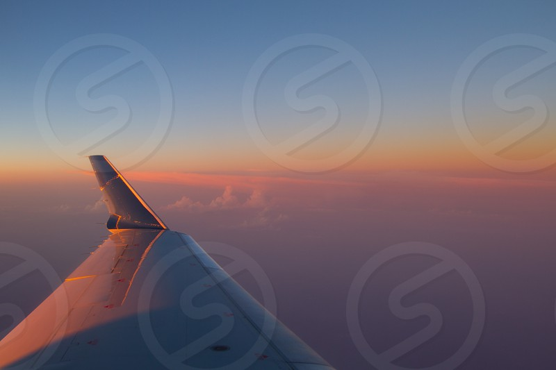 Aerial sunset airplane wing travel sky photo