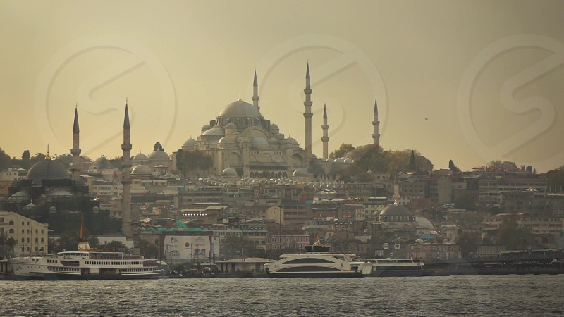 Golden Horn of Bosphorus strait with travel shipslooking to Suleymaniye Mosque on a sunset sky Istanbul Turkey. Slow motion Full HD video 240fps 1080p. photo