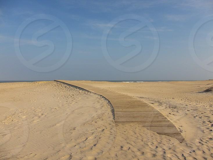 Sand covered boardwalk at Assateague National Seashore Maryland photo