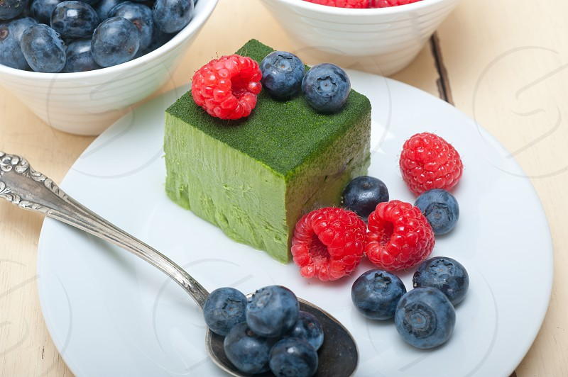 green tea matcha mousse cake with berries photo