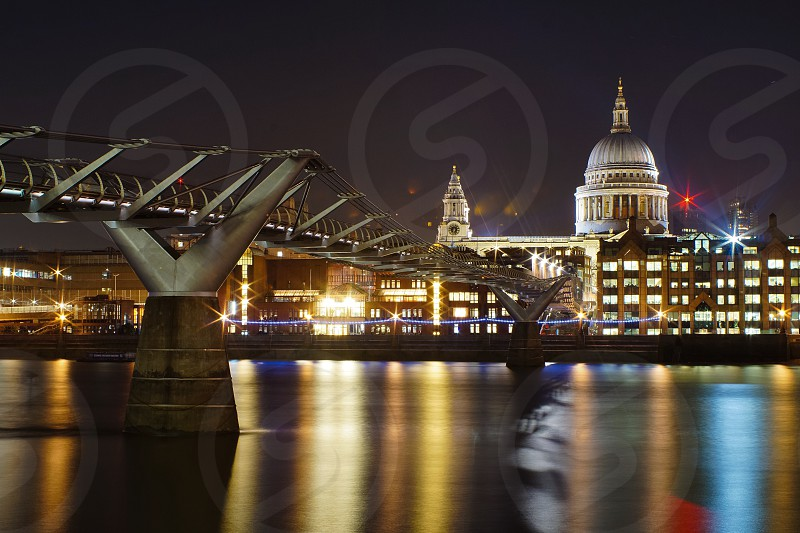 The millennium bridge and Saint Paul's Cathedral at night photo