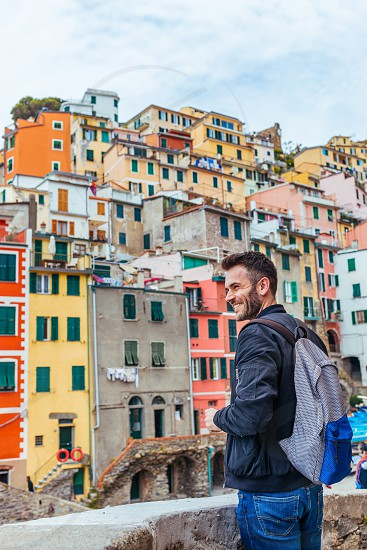 Young man traveling through Europe Cinque Terre Italy photo