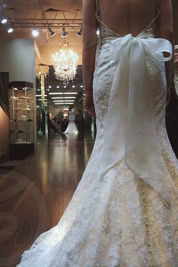 white lace backless wedding gown photo
