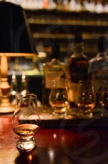 Whiskey scotch flight tasting bottles bar photo